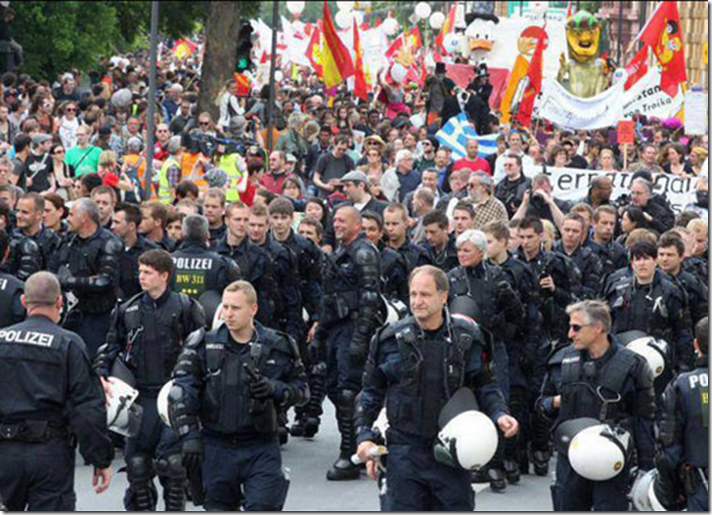 1. Frankfurt, Germany, 2011 - German riot officers take off their helmets and escort Occupy protesters
