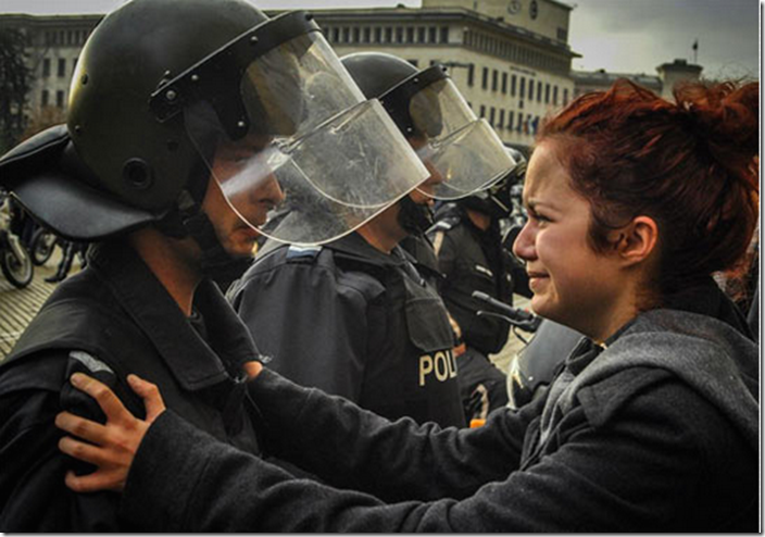 14. Sofia, Bulgaria, 2013 - Riot police and protesters share a cry together