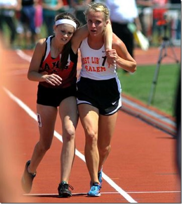 17-year-old Meghan Vogel helping her competitor to cross the finish line