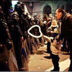 19.-Bucharest-Romania-2012-A-young-boy-offers-a-heart-shaped-baloon-to-police.-1_thumb.png