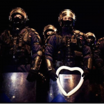 19.-Bucharest-Romania-2012-A-young-boy-offers-a-heart-shaped-baloon-to-police.-2_thumb.png