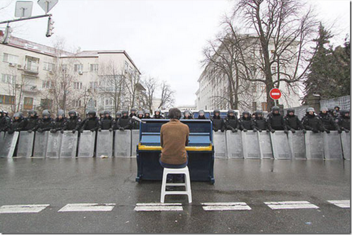 7. Kiev, Ukraine, 2013 - Man playing piano for police