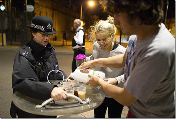 9. London, England, 2011 - Caring citizens offer tea to British riot police