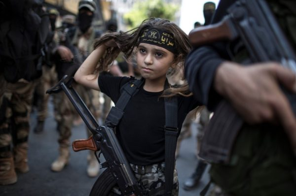A Palestinian girl armed among militants.