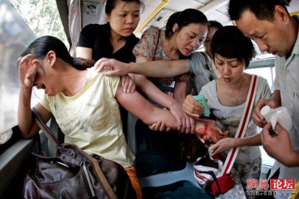 Bus passengers attempt to rescue a passenger attempting suicide.