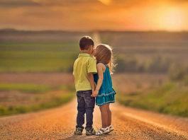 Little Boy And Little Girl Kiss