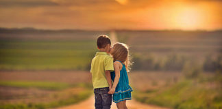 Little Boy And Little Girl Kiss